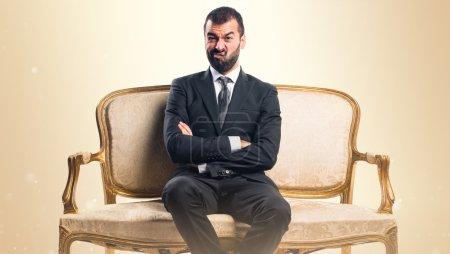 Photo for Sad Businessman sitting on armchair - Royalty Free Image