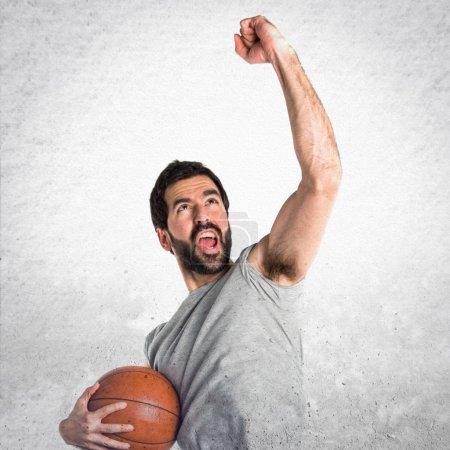 Lucky man playing basketball