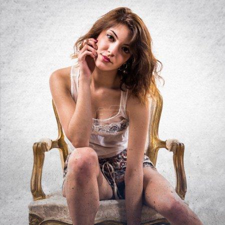 Model woman on armchair