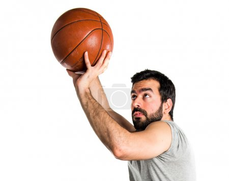 Man playing basketball jumping