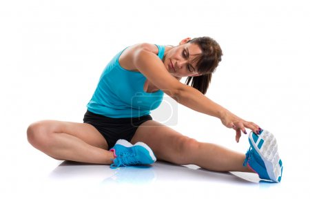 Pretty sport woman stretching