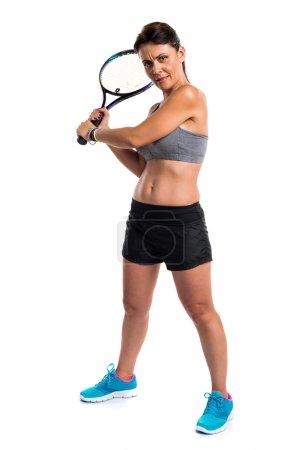 Pretty woman playing tennis