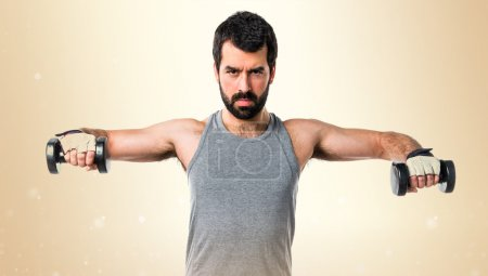 Brunette man over ocher background
