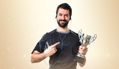 Sportman holding a trophy