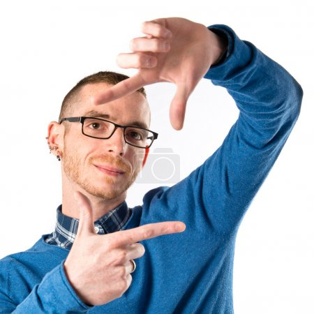 Man focusing with his fingers on a white background