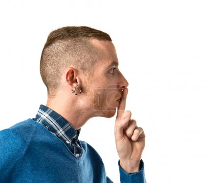 Photo for Man making silence gesture over isolated white background - Royalty Free Image