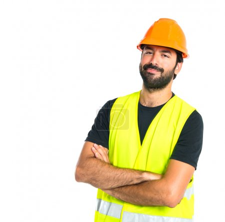 Photo pour Ouvrier avec les bras croisés sur fond blanc - image libre de droit