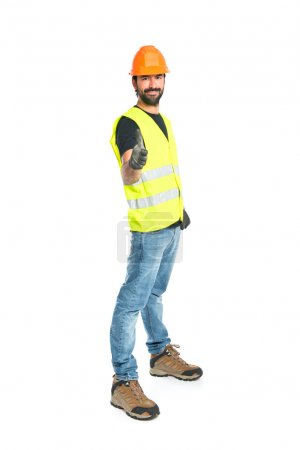 Workman with thumb up over white background
