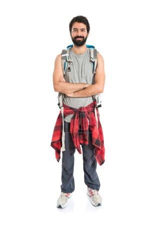 Photo pour Sac à dos avec les bras croisés sur fond blanc - image libre de droit