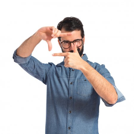 Young hipster man focusing with his fingers