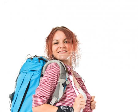 Pretty backpacker over isolated white background