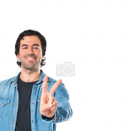 Man doing victory gesture over white background