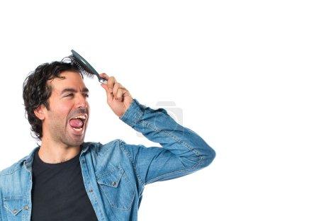 Photo pour Homme avec peigne sur fond blanc - image libre de droit