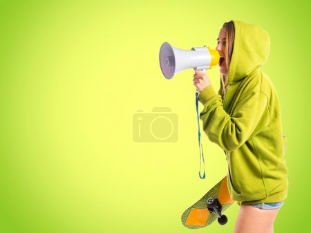 Young girl shouting over green background