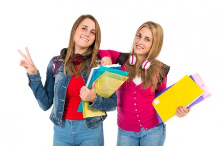 Student women making Ok sign over white background