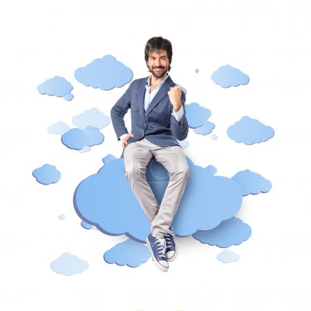 Lucky man over clouds background