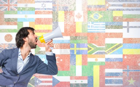 Man shouting over flags background