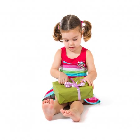 Photo for Kid holding a present over white background - Royalty Free Image