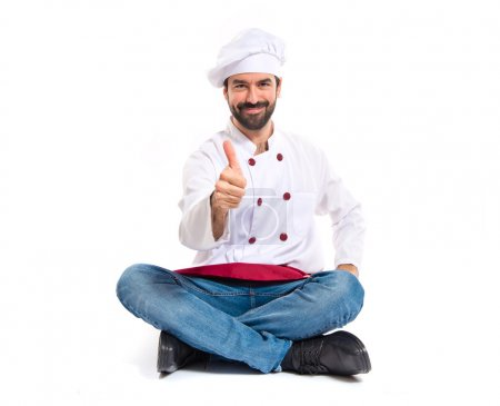 Chef with thumb up over white background