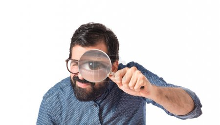Young hipster man with magnifying glass