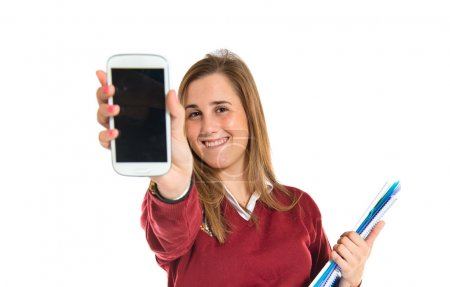 Student talking to mobile over white background