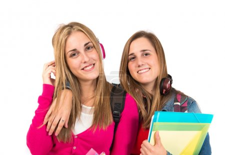 Students listening music over white background