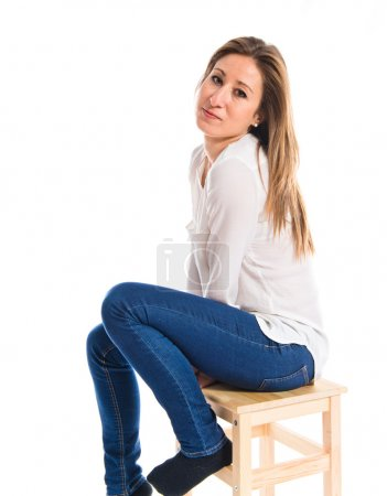 Pretty blonde girl sitting on chair