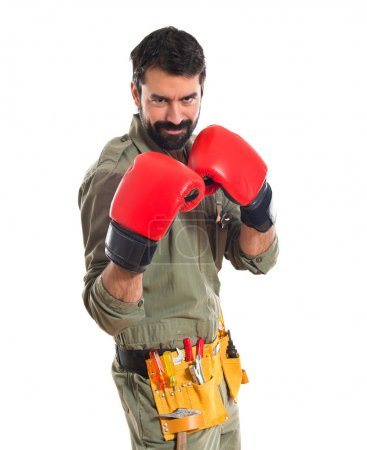 Mechanic with boxing gloves