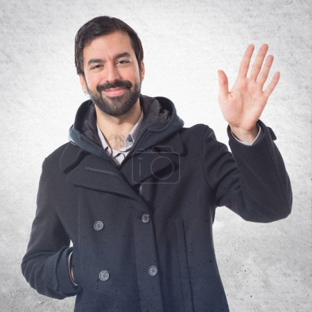 Man saluting over white background