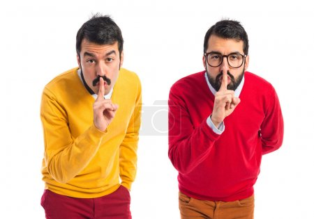 Photo for Twin brothers making silence gesture - Royalty Free Image