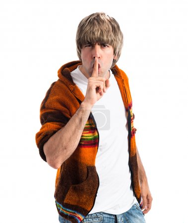 Blonde man making silence gesture
