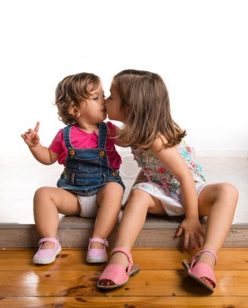 Photo for Sisters kissing - Royalty Free Image