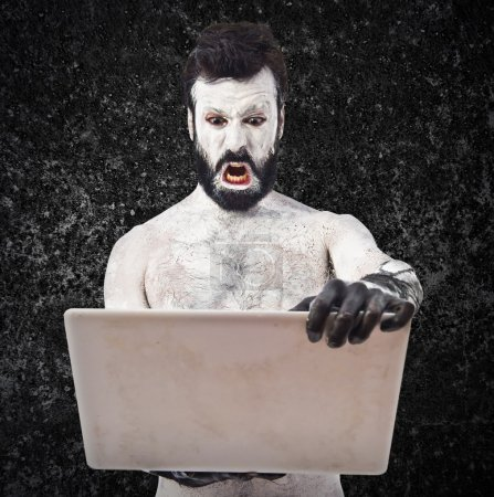 Photo for Old civilisation man with laptop - Royalty Free Image