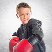 Kid with boxing gloves