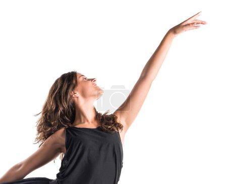 Ballerina dancing over white