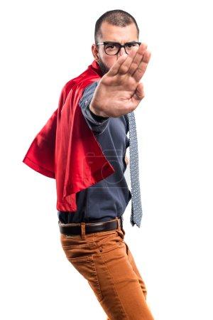 Super hero making stop sign
