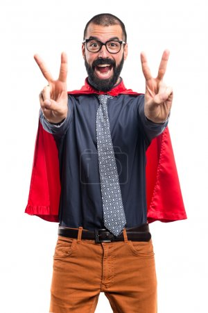 Super hero doing victory gesture
