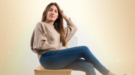 Pretty girl in over ocher background