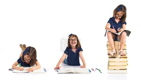 Girl studying on a pile of books