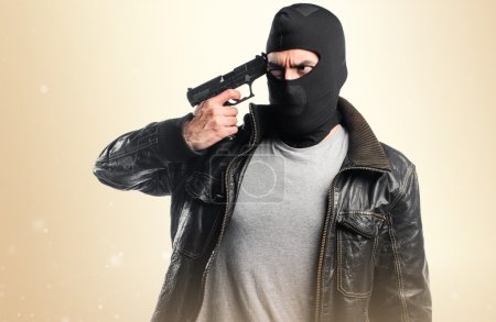 Robber shooting with a pistol
