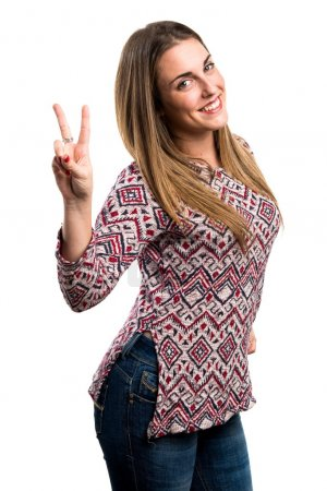 Blonde woman doing victory gesture