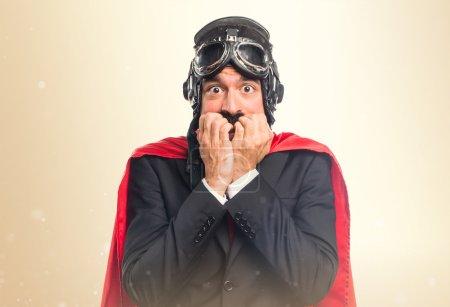 Frightened super hero businessman