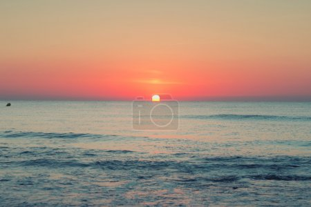 Sunrise on sea beach and clouds