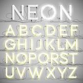 Realistic neon alphabet with wires (ON) vector
