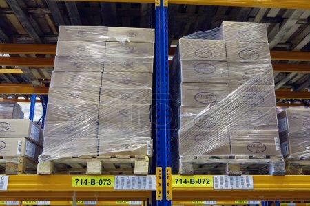 Pallets with boxes stand on a shelf goods warehouse.