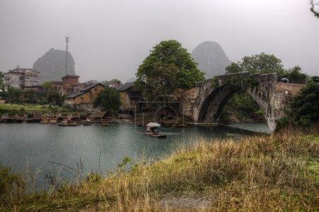 Dragon Bridge on Yulong River, Yangshuo, Guilin, Guangxi Province, China.