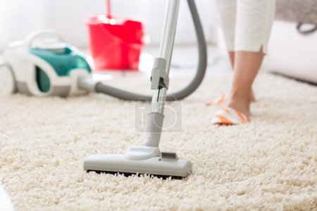 Photo for Suction grey carpet cleaning with vacuum cleaner - Royalty Free Image