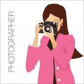 Young cute woman holding the camera