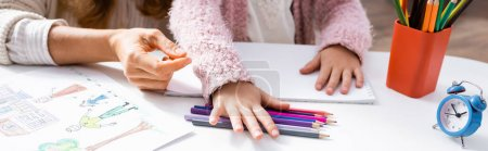 Photo for Cropped view of little girl drawing pictures with colorful pencils while visiting psychologist, banner - Royalty Free Image