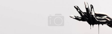 Photo for Cropped view of hand with dripping black paint isolated on white - Royalty Free Image